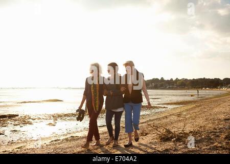 Female family members walking on beach - Stock Photo