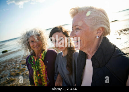 Female family members chatting on beach - Stock Photo