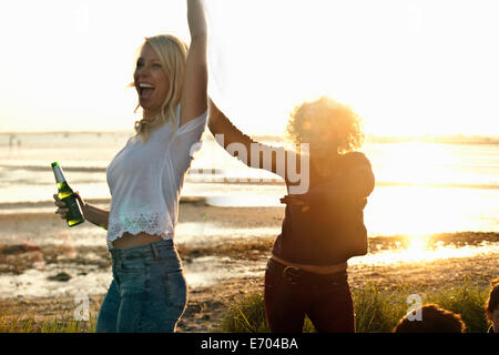 Mother and daughter partying on Bournemouth beach, Dorset, UK - Stock Photo