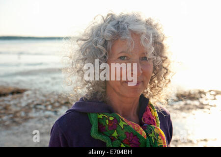 Close up of mature woman by beach - Stock Photo