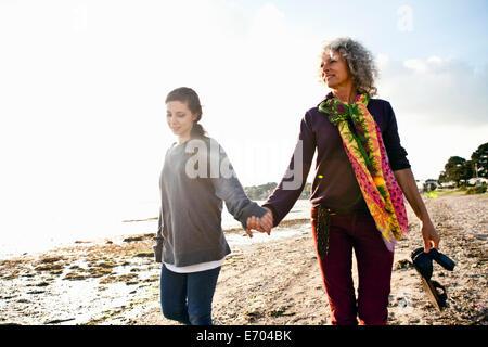 Mother and daughter enjoying beach - Stock Photo