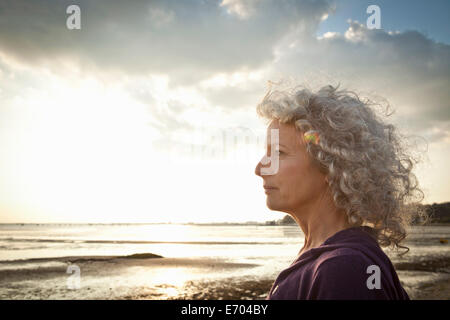 Mature woman enjoying beach - Stock Photo