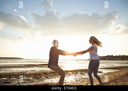 Young couple enjoying beach