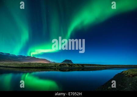 Aurora Borealis above Grundarfjordur, Mt. Kikjufell in centre, Snaefellsnes, Iceland - Stock Photo
