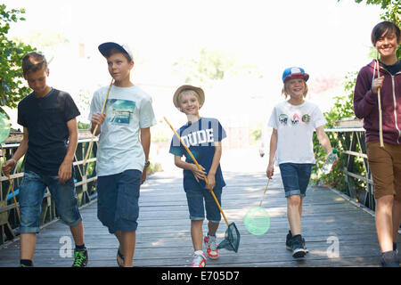 Group of boys on bridge with fishing nets - Stock Photo