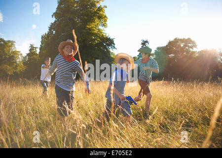 Group of young boys playing in field - Stock Photo