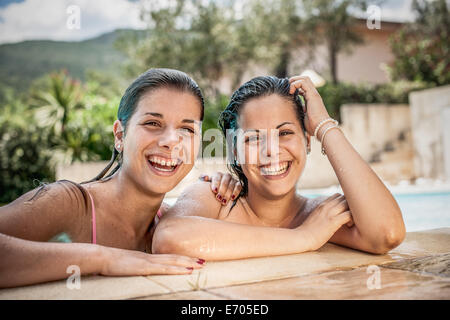 Portrait of young women in swimming pool, Capoterra, Sardinia, Italy - Stock Photo