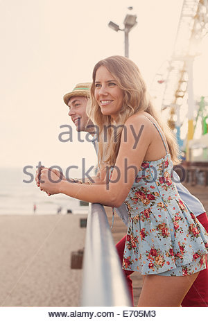 Young couple on Santa Monica pier, California, USA - Stock Photo