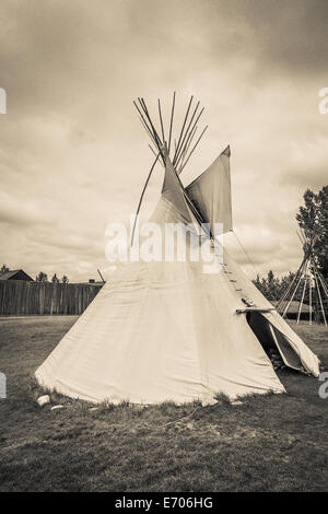 A tepee (tipi, teepee) is a Plains Indian home. It is made of buffalo hide fastened around very long wooden poles, - Stock Photo