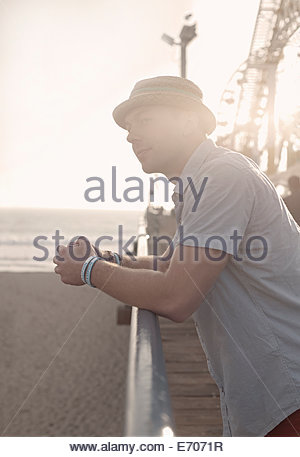 Young man gazing from Santa Monica pier, California, USA - Stock Photo