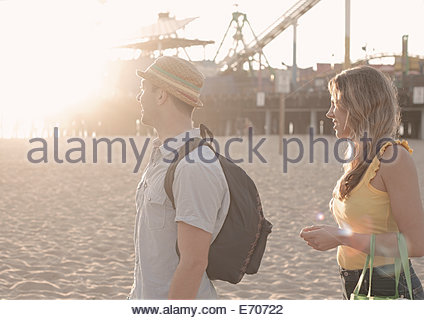Young couple strolling on beach, Santa Monica, California, USA - Stock Photo