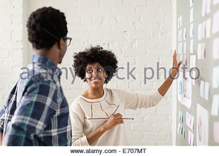 Two colleagues working in creative studio - Stock Photo