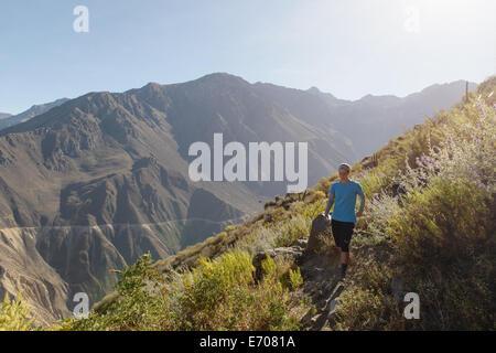 Young woman jogging in Colca Canyon, Cabanaconde, Peru - Stock Photo