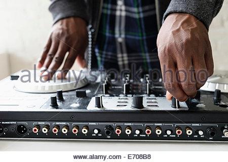 DJ using mixing desk, close up - Stock Photo