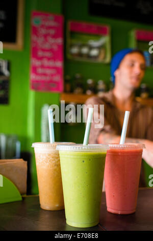 Organic smoothies on table in cafe - Stock Photo