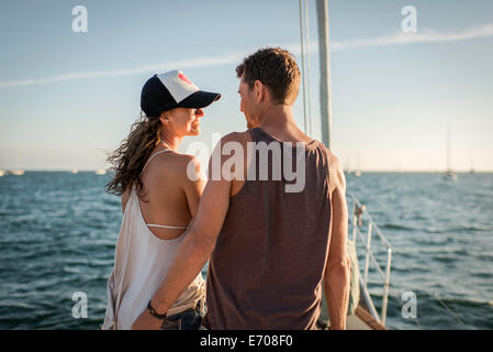 Couple on boat in ocean, rear view - Stock Photo