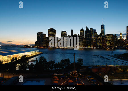 View of the river and lower Manhattan at dusk, New York, USA - Stock Photo