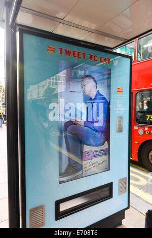 Oxford Street, London, UK. 2nd September 2014. A video of  Gary Lineker plays on a screen on the bus stop vending - Stock Photo