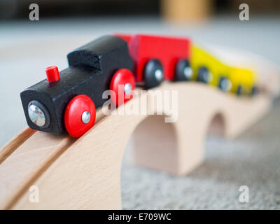 Wooden toy train over wooden toy bridge - Stock Photo