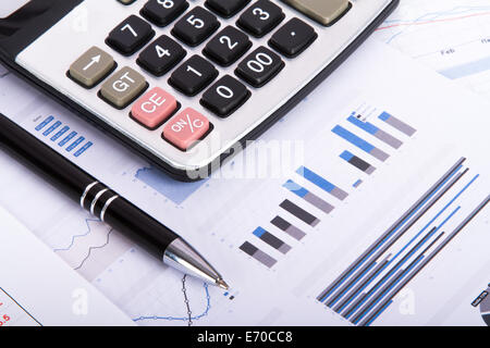 Finance concept, financial and stock market graphs, charts analysis on business table for success. - Stock Photo