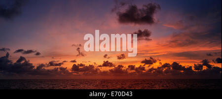 Picturesque beautiful panoramic view of the sky at sunset over tropical ocean - Stock Photo