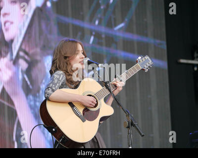 Young up and coming singer songwriter Jerry Williams performing at the victorious festival in Portsmouth England - Stock Photo