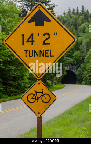 A sign warns cars and bikers of a tunnel coming up along the Blue Ridge Parkway - Stock Photo