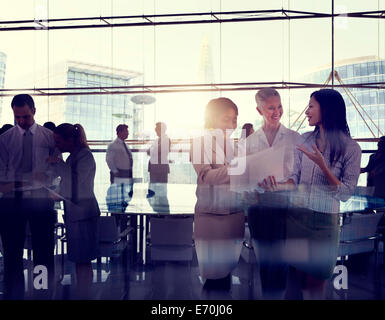 Silhouettes Of Multi-Ethnic Group Of Business People Working Together In A Board Room - Stock Photo