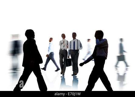 Business People Silhouettes Commuting and Isolated on White - Stock Photo