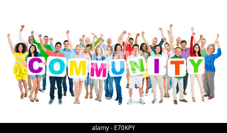 Group of Multi-Ethnic Business People Raising Their Hands And Holding Placards That Form Community - Stock Photo