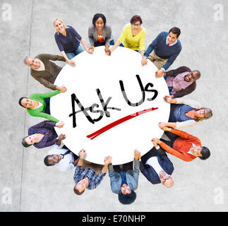 Multiethnic People in Circle with 'Ask Us' Concept - Stock Photo