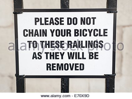 London UK Warning sign not to chain bike to railings on a building in Whitehall - Stock Photo