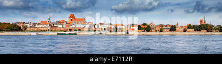 Panoramic view of old town in Torun on Vistula bank, Poland. - Stock Photo