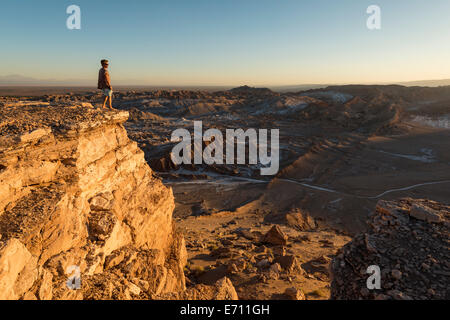 Man on cliff, Valle de la Luna (Valley of the Moon), Atacama Desert, El Norte Grande, Chile - Stock Photo