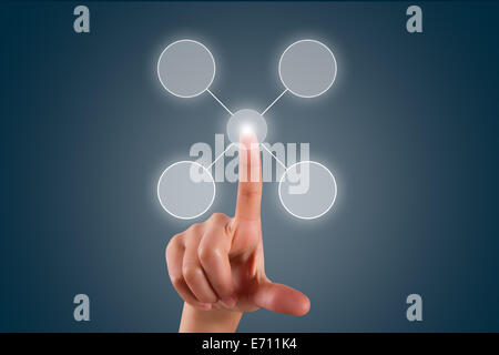 Young female hand finger touching, pressing or choosing selection list in digital screen on dark background. - Stock Photo