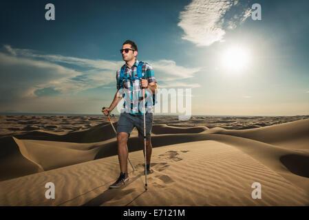 Man hiking in Glamis sand dunes, California, USA - Stock Photo
