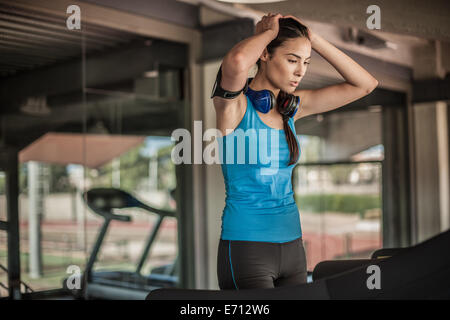 Young woman resting in gym - Stock Photo