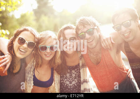 Five friends with arms around each other, portrait - Stock Photo
