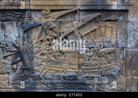 Borobudur, Java, Indonesia.  Detail Showing a Boat in Bas-relief Carvings Showing Scenes from the Life of the Buddha. - Stock Photo