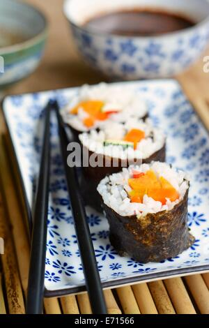 Vegetarian sushi with carrots, zucchini, sweet potato and bell pepper - Stock Photo