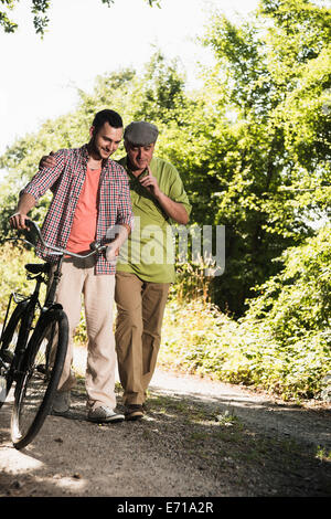 Father and son taking a walk - Stock Photo