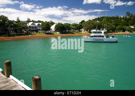 Fishing charter boat on the Bay of Islands at the waterfront town of Russell, North Island, New Zealand. - Stock Photo
