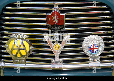 Close Up Of Badges On The Front Of An Old Morris Minor