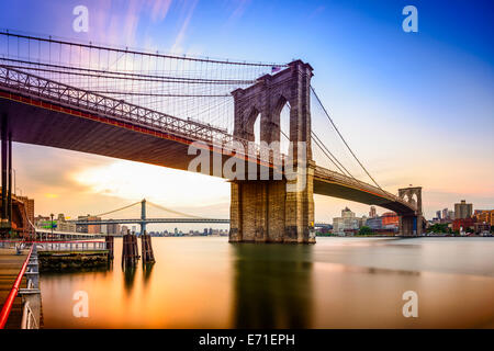 New York City, USA at the Brooklyn Bridge and East River at dawn. - Stock Photo
