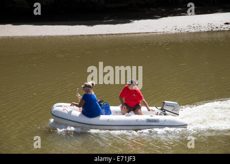 The Mahurangi River at Warkworth North Auckland Peninsula New Zealand Couple in rubber dingy going upriver - Stock Photo