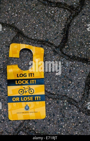Discarded sign warning of bike theft and possible precautions, Vancouver, Canada - Stock Photo