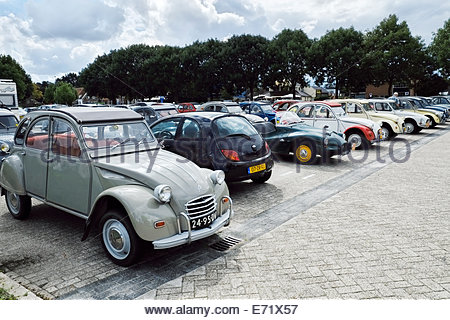 A Citroën 2CV Enige Echte Eenden (Only Real Ducks) Club 35-Year Jubilee gathering in a small city in The Netherlands. - Stock Photo