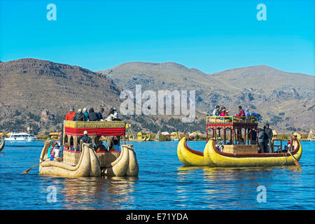 Boats off the floating islands of the Uros on Lake Titicaca, Peru - Stock Photo