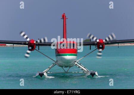 Hydroplane, De Havilland Canada DHC-6 Twin Otter, frontal view, on water, Maldives - Stock Photo