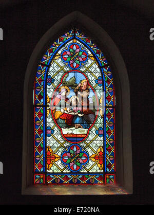 Stained glass window depicting saint Anne and saint Joachim in a church in Chateau-Chalon, Jura region, France - Stock Photo